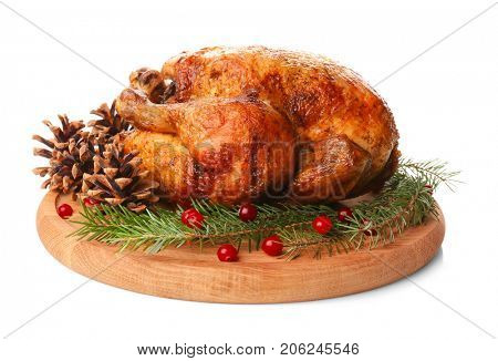Wooden board with roasted turkey, cones and fir tree branches on white background