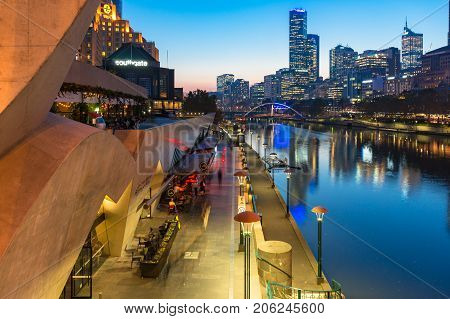 Melbourne Southbank Promenade With Restaurants And Cbd View At Dusk