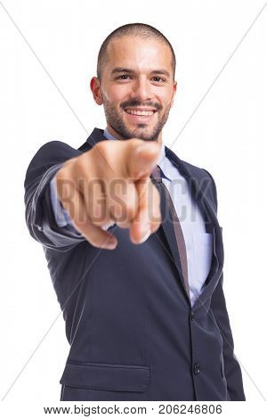 Handsome businessman pointing the finger at you, isolated on a white background