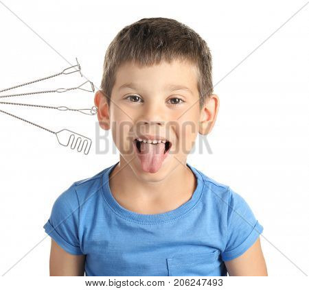 Cute boy and logopedic probes for speech correction on white background