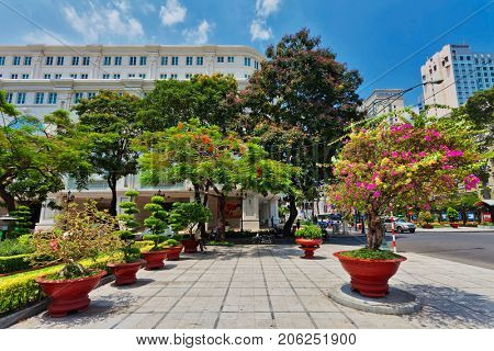 HO CHI MINH, VIETNAM - APRIL 28, 2014: View at one of central streets of Ho Chi Min city with Famous Hotels - Sheraton, Caravelle