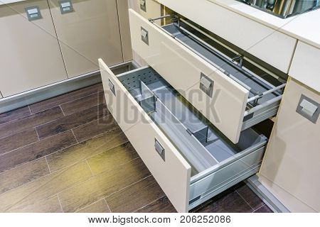 Opened kitchen drawer with plates inside a smart solution for kitchen storage and organizing