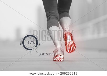 very active young beautiful woman busy running on the promenade along the ocean side with a big modern city in the background to keep up her fitness levels as much as possible with pressure