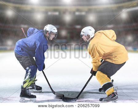 ice hockey sport players comptetition concpet in front of big modern hockey arena with flares and lights