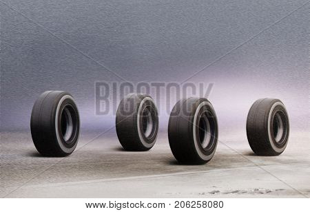 four automobile wheels rush on winter road in  	snowstorm