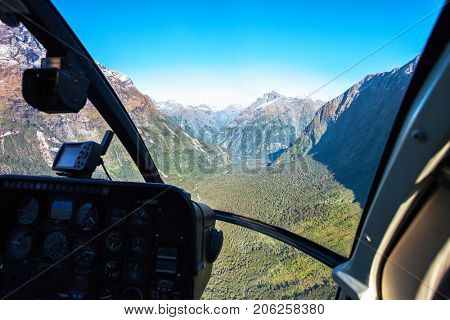 Scenic helicopter flight with view from cockpit,  Milford Sound , Fiordland National Park, South Island, New Zealand