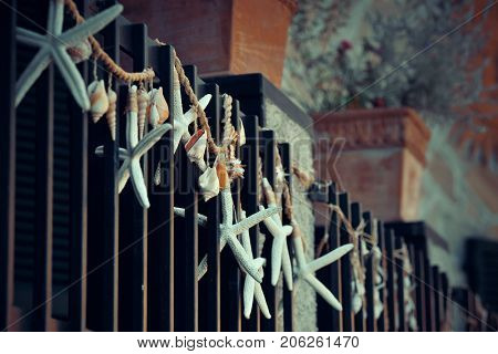 Monterosso street view with decoration on fense in Cinque Terre in Italy