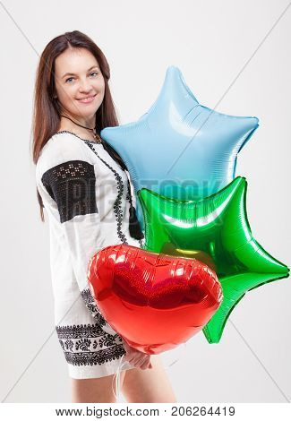 happy woman with balls on a light background