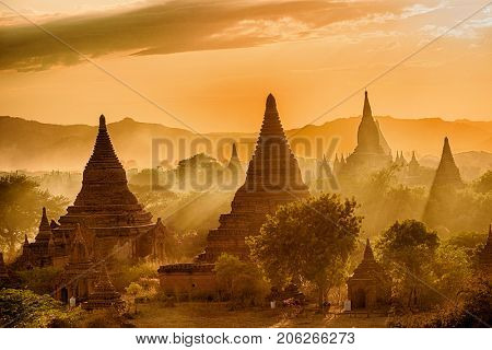 Sun is setting over old pagodas of an ancient city of Bagan, Myanmar
