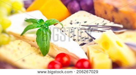 Closeup photo of a tasty cheese assorted, blue cheese, brie, camembert, cheddar, gouda, luxury French cheese, delicious restaurant menu, Thanksgiving table