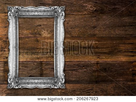 Old Silver Picture Frame on wood baclground