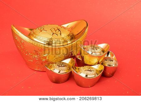 Chinese gold ingot mean symbols of wealth and prosperity.Chinese calligraphy Translation:good bless for money