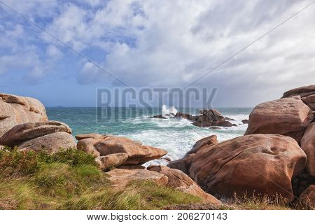 Huge boulder and the boiling sea at Ploumanach, Pink Granite Coast in Brittany