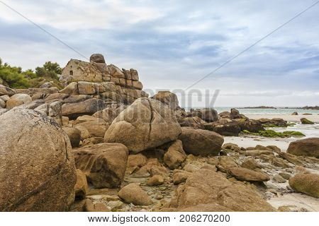 Maison des Douaniers, ancient customs house in the rocks of Brittany beach at Cléder