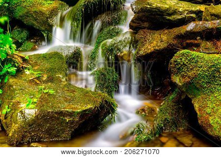 nice small waterfall on mountain brook