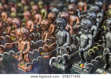 Pissing Boy (Manneken Pis) toys in souvenir shop - symbol of Brussels Belgium