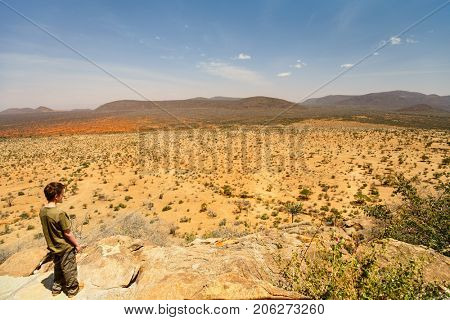 Teenage boy enjoying views in Samburu national park in Africa