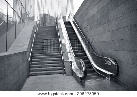 Outdoor escalator with modern building