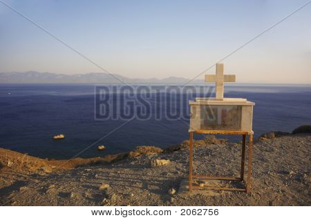 Crucifix On The Edge With Ocean In Background