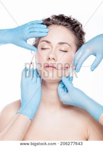 Aesthetic medicine. Young beautiful woman having face injections. Anti-aging skincare, beauty and plastic surgery concept.