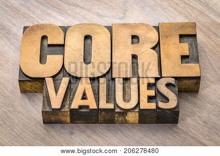 core values  banner  -  word abstract in vintage letterpress wood type blocks against grained wooden background