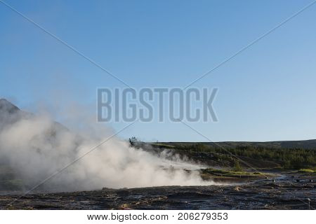 Geyser Strokkur. South western part of Iceland in the geothermal area. Sunny day with clear blue sky. Amazing nature
