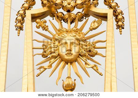 The golden gate of the Palace of Versailles, or Chateau de Versailles, or simply Versailles, in France.