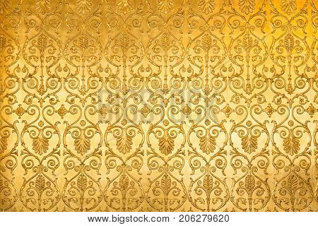 Golden floral ornament brocade textile pattern.
