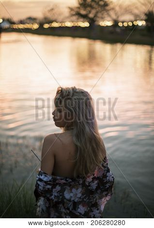 Woman Standing by the Pon in Music Festival