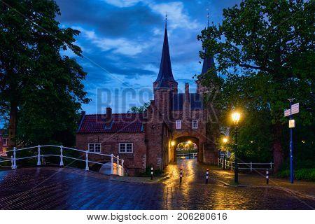 Oostport (Eastern Gate) of Delft illuminated at night. Delft, Netherlands