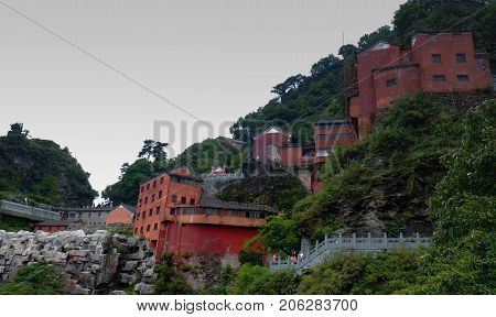 The Wudang MountainsHubei China. Many Taoist monasteries to be found thereIt's world heritate and famous in one of China. It's red temple and red wall. It's a good weather.And It's especially name.