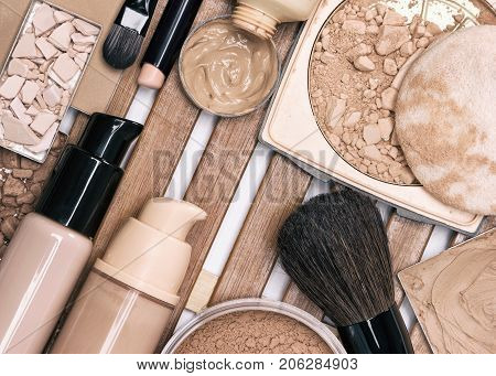 First step of makeup application - foundation products. Concealer stick, primer, liquid and cream foundation, different types of powder