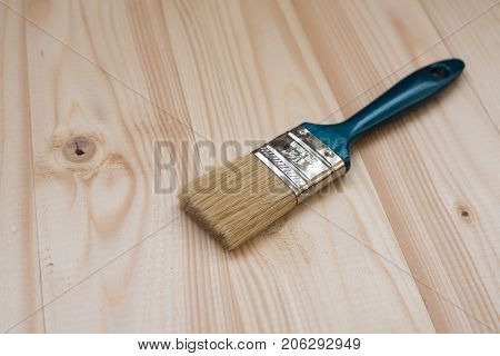 brush on wooden background, top view concept of repair. copy space, space for text. brush on wooden background