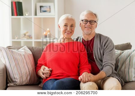 old age and people concept - happy smiling senior couple at home