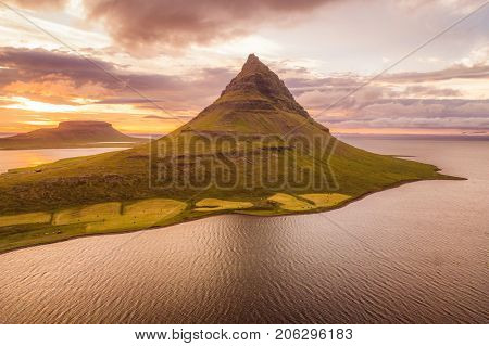 Iceland nature Kirkjufell mountain landscape in West Iceland on the Snaefellsnes peninsula. Icon of Iceland travel and most photographed icelandic mountain. drone aerial view from above.