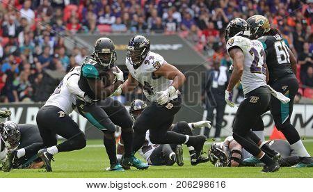 LONDON, ENGLAND - SEPTEMBER 24: Leonard Fournette running back for Jacksonville Jaguars breaks through the Ravens defence during the NFL match between The Jacksonville Jaguars and The Baltimore Ravens