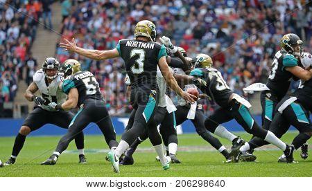 LONDON, ENGLAND - SEPTEMBER 24: Brad Nortman of Jacksonville Jaguars kicks the ball during the NFL match between The Jacksonville Jaguars and The Baltimore Ravens at Wembley Stadium on September 24