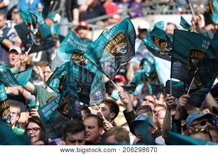 LONDON, ENGLAND - SEPTEMBER 24: fans wave flags during the NFL match between The Jacksonville Jaguars and The Baltimore Ravens at Wembley Stadium on September 24, 2017