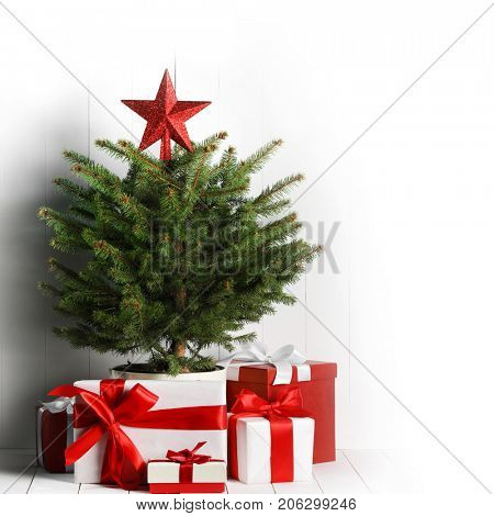 Merry christmas card with decorated christmas tree and gifts