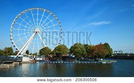 Great wheel of Montreal with his panoramic view 60 of meters high, and a breathtaking view of the river, Old Montreal and downtown city during the day