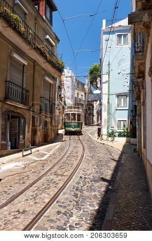 Old Tram Number 28 On The Narrow Street Of Alfama. Lisbon. Portugal