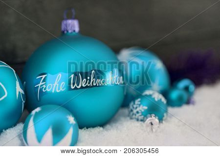 Blue christmas ball with Frohe Weihnachten (Merry Christmas) text