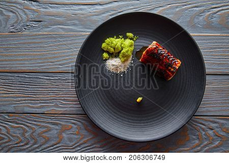 Grilled smoked eel with green apple and citrus with Sichuan Electric flower