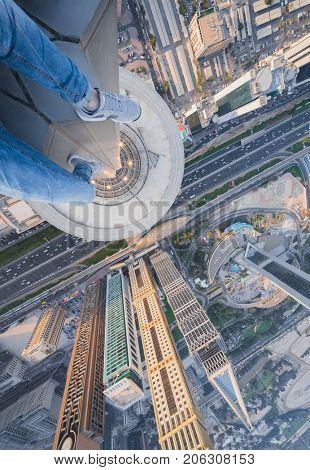 Male legs of rooftop of Millennium Plaza Hotel Dubai on Sheikh Zaid Highway, Tower, Al Yaqoub Tower, Capricorn Tower, Maze Tower, Dubai, UAE