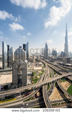 Big transport junction Burj Khalifa and other skyscrapers in Dubai city, UAE