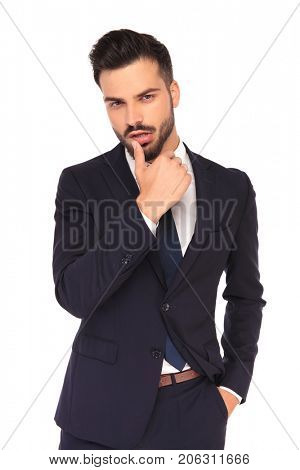 sexy young business man touching his lips with finger on white background