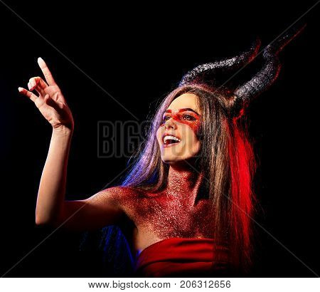 Mad satan woman on black magic ritual of hell. Witch reincarnation mythical creature Sabbath. Devil absorbing soul Halloween Astral beings are among us Make-up for night club for demon inflicts damage