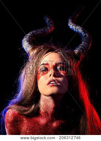 Mad satan woman on black magic ritual of hell. Witch reincarnation mythical creature Sabbath. Devil absorbing soul Halloween. Astral travel. Make-up for night club for demon inflicts damage.