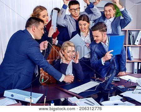 Business mad people office life of team people working with papers sitting table. Conflict new employee and business company. Chief is strangled by employee's wire. Team needs psychological help.