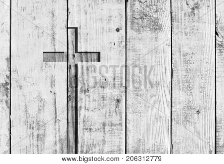 White old christian religion symbol cross shape as sign of belief on a grungy textured church wall or rustic aged background or backdrop, copy space for conceptual spirituality or resurrection design